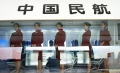 Flight attendant candidates prepare for a job interview held by Hainan Airlines in an airline cabin simulator in Harbin, capital of northeast China's Heilongjiang Province, March 8, 2012. The company, China's fourth largest airlines, plans to enroll 1,000 would-be flight attendants from twenty cities including Beijing, Tianjin, Changchun, Shenyang and Harbin. (Xinhua/Li Yuze)