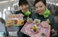 Flight attendants, holding Hello Kitty-themed in-flight meals, pose inside an Eva Airlines aircraft in Taoyuan International Airport, northern Taiwan, April 30, 2012. REUTERS/Pichi Chuang