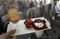 A Hello Kitty-themed in-flight dessert set is displayed inside an Eva Airlines aircraft in Taoyuan International Airport, northern Taiwan, April 30, 2012. REUTERS/Pichi Chuang