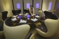 "A waitress poses as she arranges a dining table inside a private room of an A380 theme restaurant during a media event before its official opening in Chongqing municipality, April 25, 2012. The restaurant, named ""Special Enjoyment"" (Chinese name ""Special Class""), is about 600 square metres in size, including the six private rooms, and can serve up to 110 customers, local media reported.<br><br>Source: Reuters"