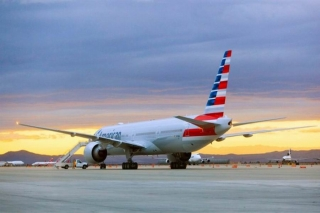 American Airline's Boeing 777-300ER is shown in new livery. The aircraft (N718AN) was painted at Victorville Airport (VCV) in California. Check the classic Delta L1011 in the background. Image from American.