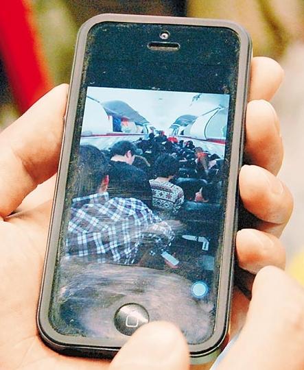 日本飞台湾一航班延误1天 乘客被警告勿拍照
