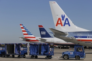 18. American Airlines - 76.93% on time. AP Photo/LM Otero