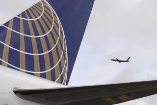 17. United - 76.94% on time. AP Photo/Eric Risberg, File