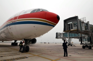 A China Eastern A330 aircraft which performs the test flight is to be connected with an air bridge at Hefei Xinqiao International Airport