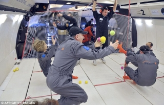Eye on the ball: Floating balls inside the aircraft display the sensation of weightlessness... and give the passengers something to play with