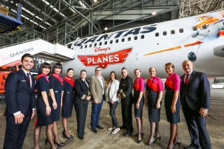 Qantas Group Executive Brand, Marketing and Corporate Affairs Olivia Wirth with John Cracknell, Managing Director, The Walt Disney Company Australia, and Qantas Cabin Crew. Photo courtesy of Qantas Airways.