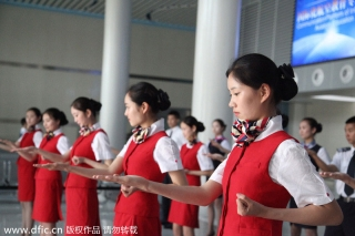 """Stewardesses-to-be practice the basics of the Ving Tsun, a form of self-defense, in Chengdu city, Southwest Sichuan province on Monday. Ving Tsun, or Wing Chun, a concept-based Chinese martial art, has been set as a compulsory course in Sichuan Southwest Vocational College of Civil Aviation. The college has signed a contract with the Tu Tengyao Martial Art Association to develop the course called """"Eighteen combat movements of anti-terror in civil aviation."""" Ving Tsun is a system of striking and grappling, especially used for close-range combat. [Photo/IC]"""