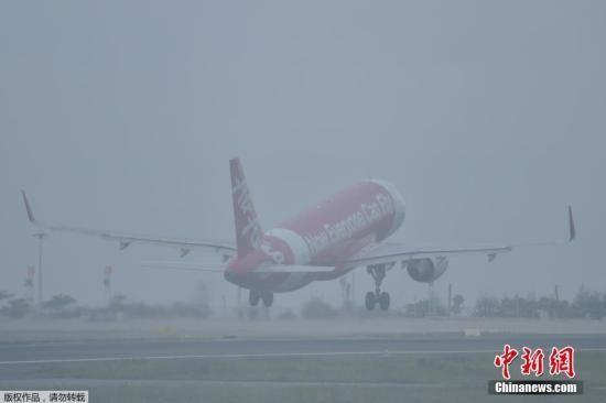 印尼烟霾继续扩散影响航班 菲律宾烟雾笼罩