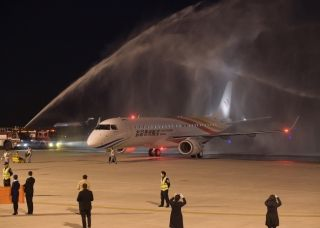 Colorful Guizhou Airlines's first E190 aircraft, Registration B-3115, touched down at Guiyang Longdongbao International Airport at 6:36 p.m. on Dec. 7. Photo by Li Feng