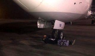 非洲机场的日常:拿不到行李机轮下面躺