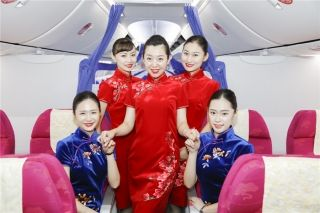 Shandong Airlines flight attendants in traditional cheongsam styles