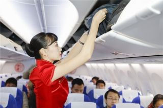 Shandong Airlines flight attendants in traditional cheongsam style