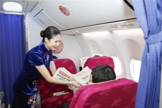 Shandong Airlines flight attendants dressed in cheongsam style on board flight SC1182 from Shenzhen to Jinan on February 1, 2016.