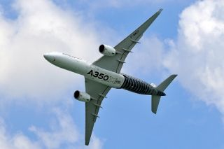 An Airbus A350 XWB flies past during the Singapore Airshow. Photo by Shen Quan
