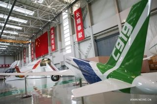 Photo taken on Feb. 29, 2016 shows a model of C919 plane demonstrated at its research base in Shanghai Aircraft Design And Research Institute of the Commercial Aircraft Corp. of China (COMAC), in Shanghai, east China. (Xinhua/Pei Xin)