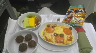 Full Disney theming: Images show food on the plane being presented in the shape of Mickey mouse.