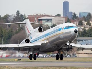The world's first Boeing 727, which first flew in 1963, makes its final landing on March 2, 2016 at Boeing Field in Seattle.  Jeremy Dwyer-Lindgren, Special for USA TODAY
