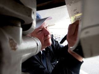 Co-pilot Mike Scott signs the nose gear door at the Museum of Flight in Seattle after completing the final flight of the first Boeing 727 on March 2, 2016.  Jeremy Dwyer-Lindgren, Special for USA TODAY