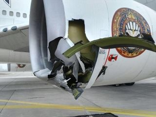 Iron Maiden's Ed Force One plane was badly damaged after crashing into a tow truck.