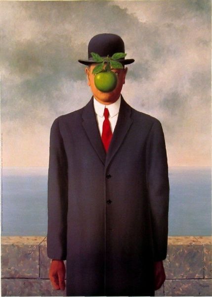 雷尼.马格利特 《戴黑帽的男人》