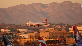 "9. Los Angeles International Airport - ""The descent over the mountains takes one from desert to the lush Pacific Coast and on a westward approach gives those on the right-hand side a bird's-eye view of downtown, the Hollywood sign and Beverly Hills,"" says poll judge Doug Gollan."