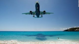 "8. St. Maarten Airport (Saint Martin) - At this Caribbean island airport, the approach is ""so low you can almost read the sunbathers' newspapers,"" says PrivateFly CEO Adam Twidell."