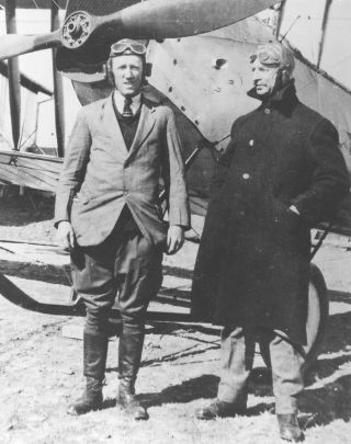 1921: Pilot Hudson Fysh (right) wearing typical early flying gear required in an open cockpit.