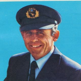 1970s: A Qantas Boeing 747 captain with the light blue Qantas pilot uniform