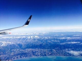 Stunning pictures show off New Zealand's beautiful snow-capped mountains and coastline from the comfort of the window seat.