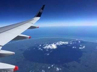 This passenger traveling from Auckland to Wellington snapped a picture of Mount Taranaki, a strato volcano, located on the west coast of New Zealand's north island.