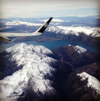 A passenger captures the dramatic mountains flying from Queenstown to Auckland during winter.
