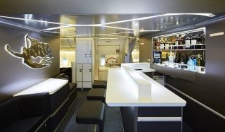 new Business Class Bar & Lounge, which will be open after the first meal service and hosted by Business Class cabin crew. Photo by Virgin Australia