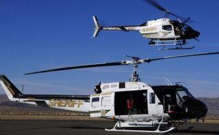 黑飞再现 美国无人机险些撞上救火直升机