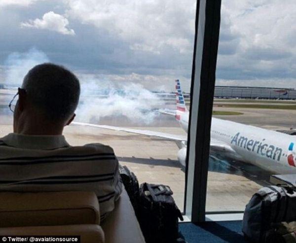 【视频】机尾冒烟 美航客机放滑梯疏散