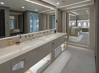 The massive master bathroom features a set of large marble his and hers sinks./Kestrel Aviation Management