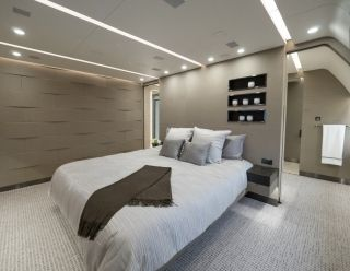 "The master suite's sleeping area features a large California king-size bed. According to Vella, the suite is designed to be an ""oasis of silence."" In fact, the noise level in the room during flight is just 48 decibels - on par with a quiet suburban home. Kestrel Aviation Management"