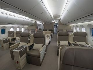 Aft of the round VIP lavatory is the guest cabin. It features 18 full-flat, first-class sleeper seats. Behind the guest cabin is a row of six premium economy seats for the staff. Kestrel Aviation Management