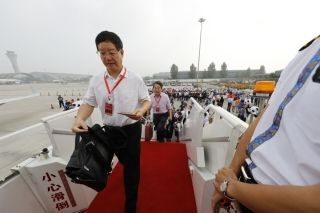 Passengers were boarding the ARJ21. Photograph by Wan Quan/China Pictorial