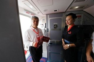 A flight attendant was welcoming passengers at the cabin door. Photograph by Wan Quan/China Pictorial