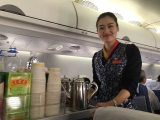 A flight attendant in beverage service