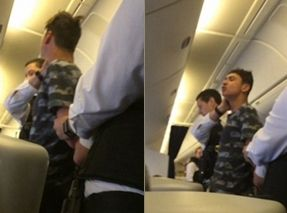 """机上酗酒吐痰咬人骂空姐 把自己""""作""""进大牢"""