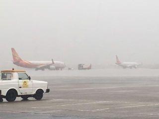 遭遇特大暴雨 2架飞海口航班返航 1架备降