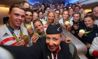 Gold medalists of Team GB pose for a selfie with a member of British Airways cabin crew prior to flying back from Rio. Photograph: Alex Livesey/Getty Images for British Airways