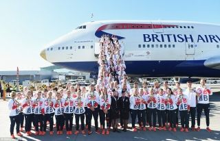 There's no place like home: Team GB athletes pose with their astonishing haul of 67 medals - including 27 golds - having arrived back at London Heathrow Airport shortly before 9.50am today after finishing second in the Rio 2016 medal table.