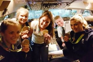 With 77 champagne bottles on board and a stirring rendition on the National Anthem before take-off, there was a carnival atmosphere on board the golden-nosed plane taking Great Britain's athletes home from Rio 2016.