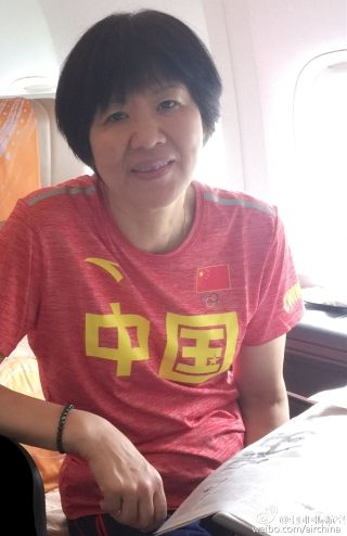 Lang Ping, head coach of Chinese woman valleyball squad on board flight CA604. Photo by Air China