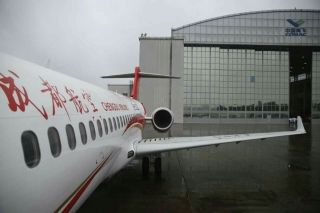 On September 29, the Commercial Aircraft Corp of China (COMAC delivered the second ARJ21-700, the country's first indigenously designed regional jet, to launch customer Chengdu Airlines. Photo by Yin Liqin/Shanghai Morning Post