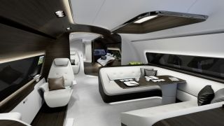 "The next room is the dining area and comes with a wraparound couch with a central table. Mercedes refers to it as a ""yacht deck divan,"" showing how the interior design plays off Mercedes' yacht design for the Monaco Yacht Show. Mercedes-Benz"