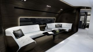 Now for the best room on the VIP plane: the entertainment zone. It comes with a more roomy wraparound couch and a smaller, coffee table. Mercedes-Benz